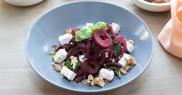 Beetroot noodles with feta, walnuts and spinach
