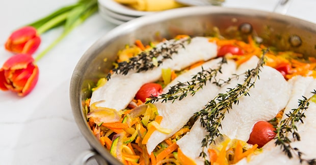 White Fish Over Vegetables