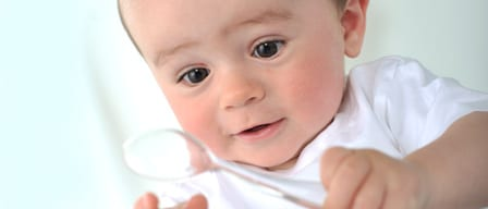 Baby with magnifying glass