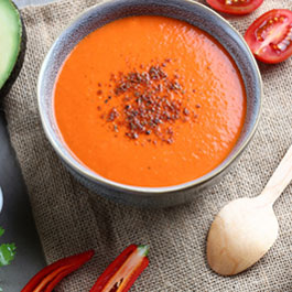 Mexican spiced red pepper & tomato soup with avocado and coriander yoghurt