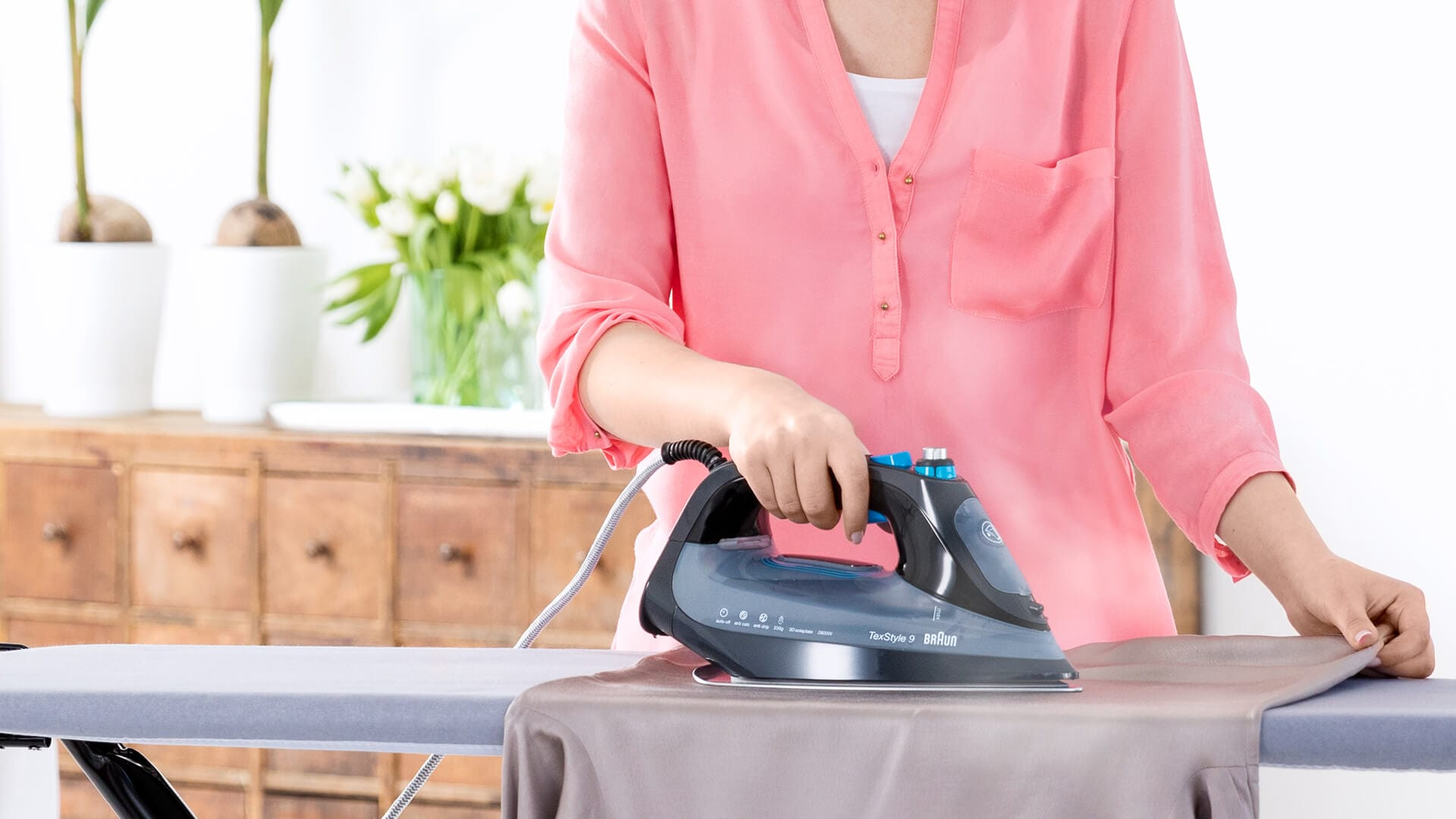 Braun TexStyle 9 Steam Iron in use
