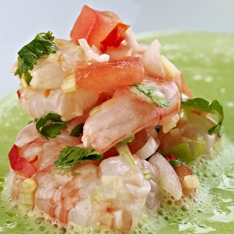 Chilled cucumber & coriander soup with ceviche of prawns & fresh herbs.