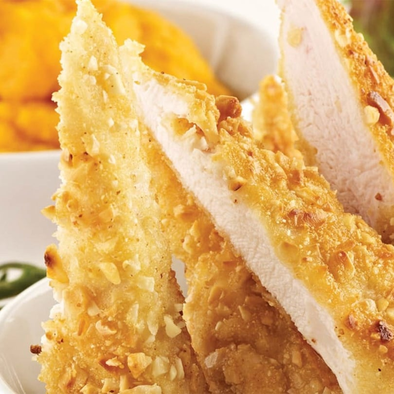Almond crusted chicken fingers with sweet potato purée.