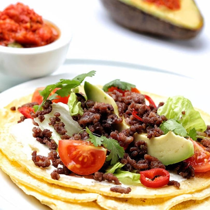 Tex-Mex beef tacos with avocado and red pepper, cherry tomato and chilli salsa.