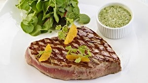 Grilled tuna with orange, olive and caper sauce